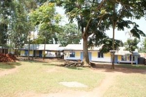 Photo from July 2014 of the school newly plastered and painted. What a difference!
